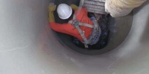 Products & Services: Worker inside manhole insert